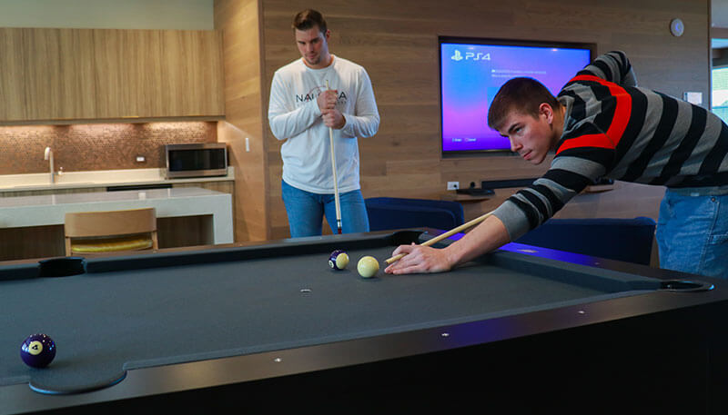 Students playing billiards at Lakeside Commons off campus student apartments