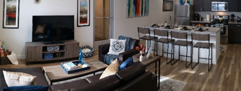 A panoramic view of Lakeside Commons living and kitchen areas